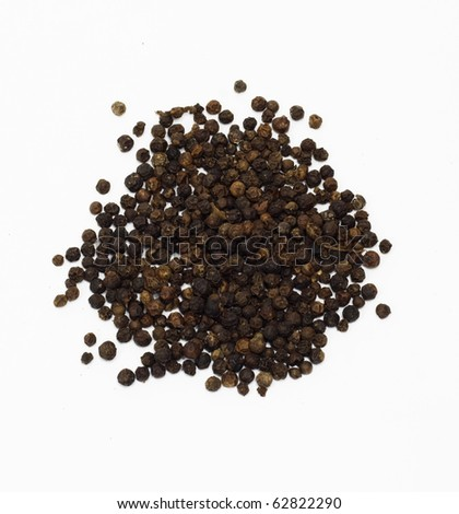Closeup of black pepper isolated on white background. - stock photo