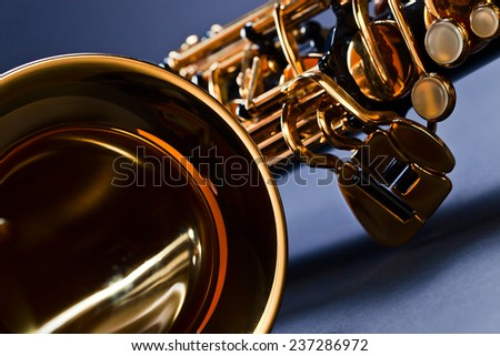 closeup of black saxophone , focus on foreground