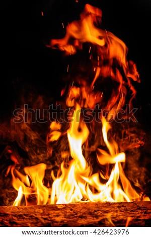 Closeup of blazing campfire in the night - stock photo
