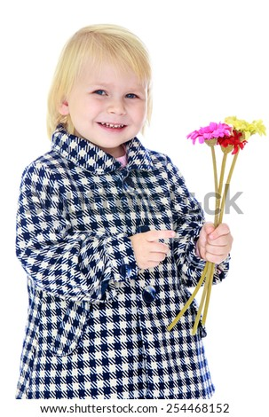 Closeup of blond little girl with a bouquet of flowers. Isolated on white.
