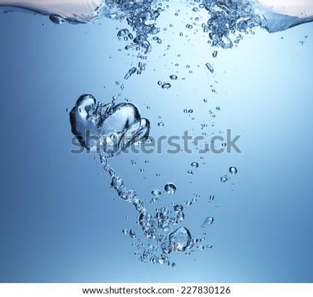 Closeup of blue bubbles underwater  - stock photo