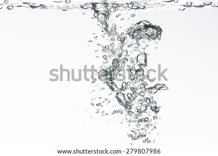 Closeup of blue bubbles underwater - stock photo