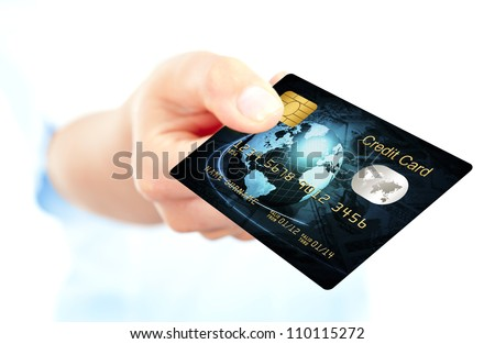 closeup of blue credit card holded by hand. focus on card - stock photo