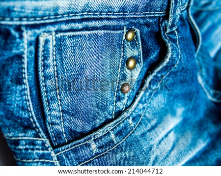 Closeup of blue jeans pocket - stock photo