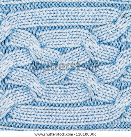 Closeup of blue knitted pattern from winter sweater - stock photo