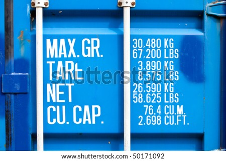 closeup of blue shipping container with white lettering