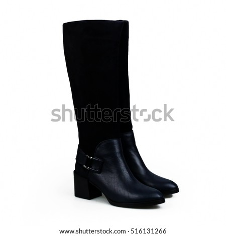 Closeup of blue suede boot against white background