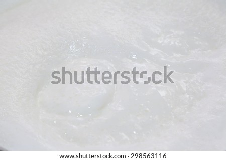 Closeup of boiling milk with bubbles - stock photo
