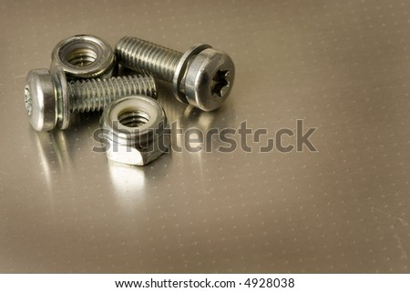 Closeup of bolts and nuts on a metal surface