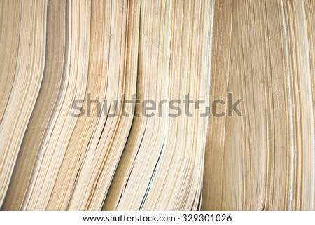 Closeup of books on the library shelves. - stock photo