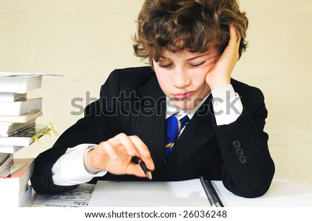 closeup of bored school boy - stock photo