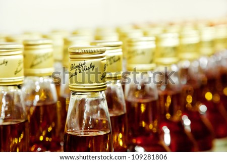 closeup of bottles of scotch blended whisky - stock photo