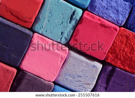 Closeup of bright pastel chalks with red,blue,violet and purple colours ,background for creative art design - stock photo