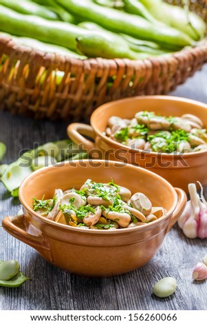 Closeup of broad beans served with parsley - stock photo