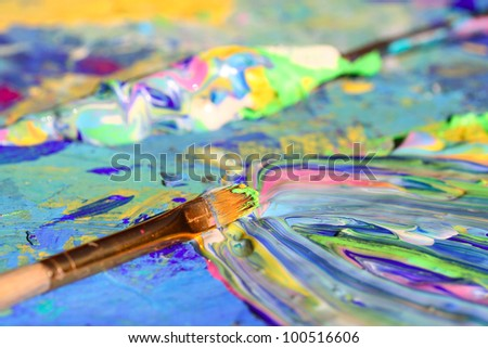 Closeup of brush and palette. - stock photo