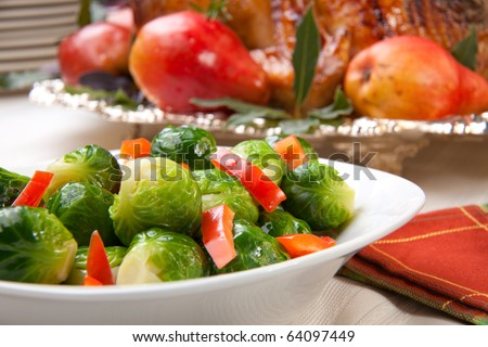 Closeup of brusssels sprouts with roasted bell pepper. - stock photo