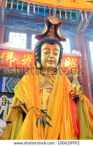 closeup of buddhism statues in a temple, north china - stock photo