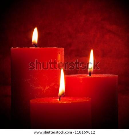 Closeup of burning candles - stock photo