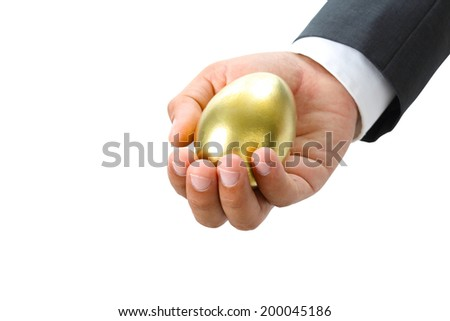 closeup of business hand holding golden egg isolate on white with clipping path - stock photo