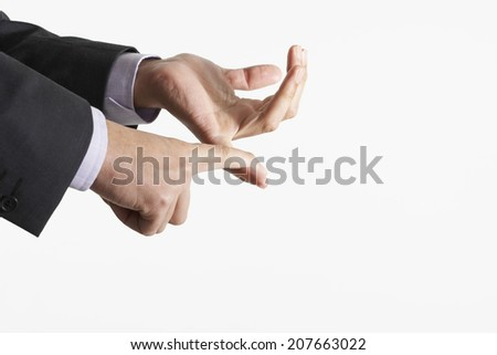 Closeup of business hands counting using fingers against white background