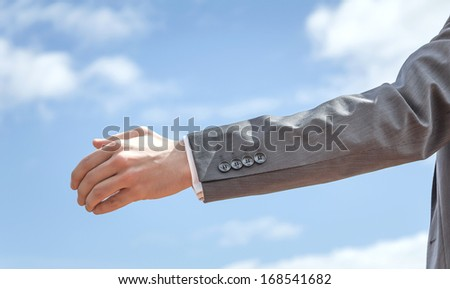 Closeup of business man showing his open hand ready for seal a deal - stock photo
