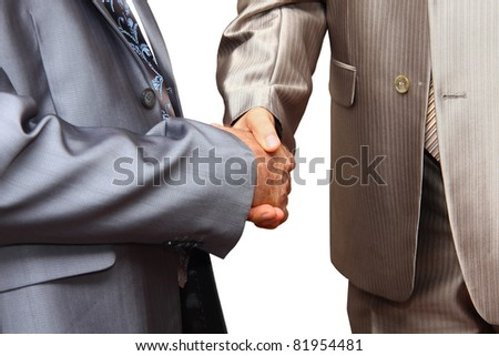Closeup of business people shaking hands over a deal - stock photo