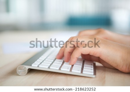 Closeup of business woman hand typing on keyboard - stock photo