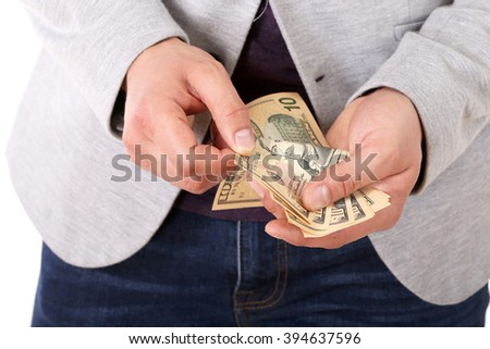 Closeup of businessman  hands counting dollar banknotes, isolated over white background - stock photo