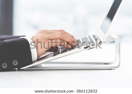 Closeup of businessman hands typing on laptop computer - stock photo
