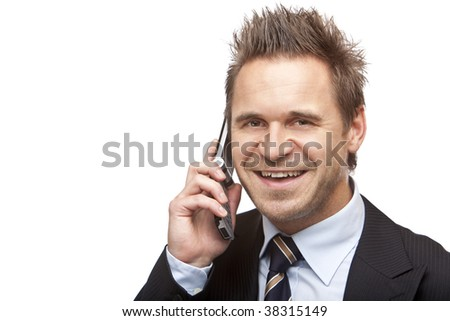 Closeup of businessman making a call and smiles happy into camera. Isolated on white background.