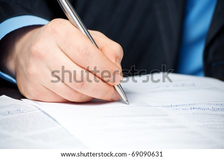 closeup of businessman`s hand signing contract - stock photo