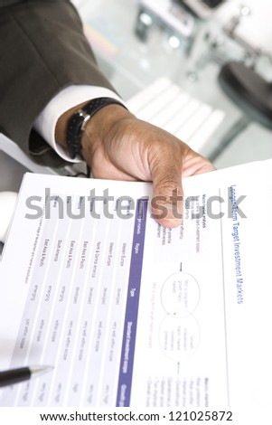 Closeup of businessman's hand with document - stock photo