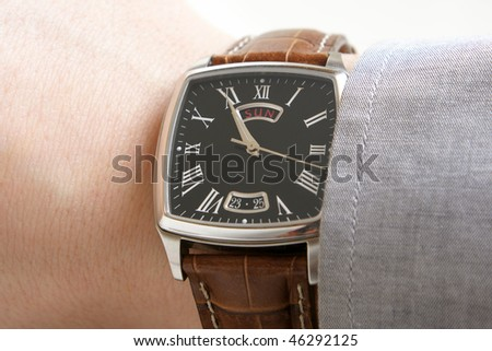 Closeup of businessman's hand with wristwatch - stock photo