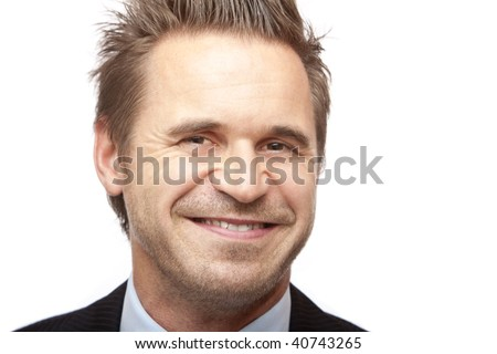 Closeup of businessman smiling into camera. Isolated on white. - stock photo