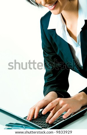 Closeup of businesswoman typing documents on the laptop isolated on white background - stock photo