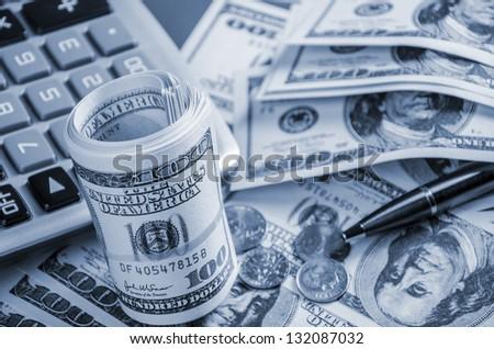 Closeup of calculator and US dollars - stock photo