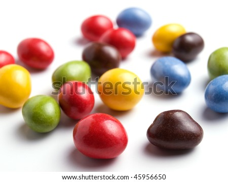 Closeup of candies in many colors on a white background. - stock photo
