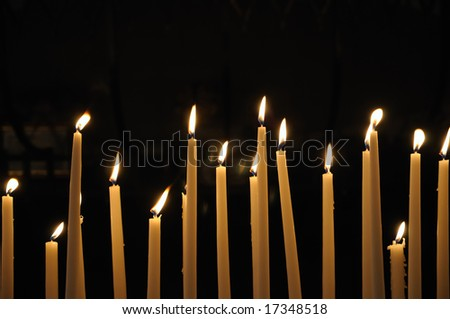 Closeup of candles in catholic church - stock photo