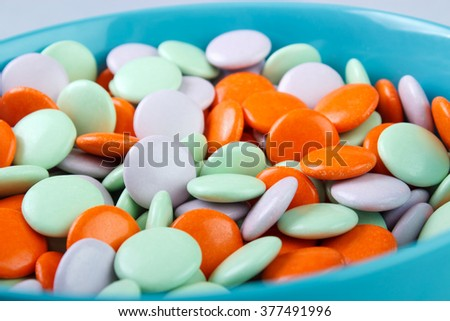 Closeup of candy coated chocolate candies on  bowl - stock photo