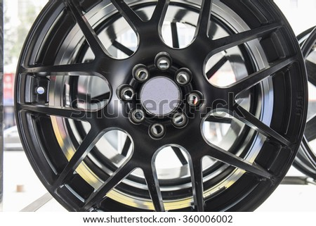 Closeup of car wheels - stock photo