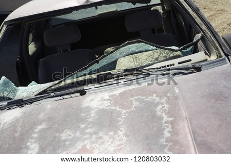 Closeup of car with broken windshield - stock photo