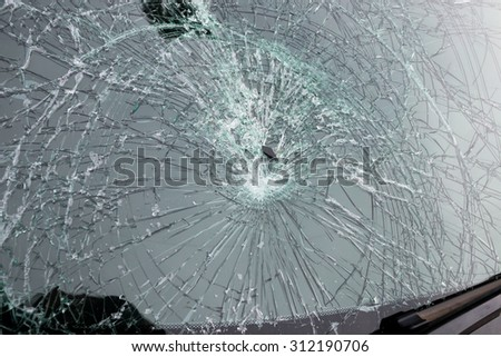 Closeup of car with broken windshield