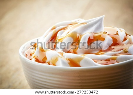 closeup of caramel latte coffee with whipped cream - stock photo