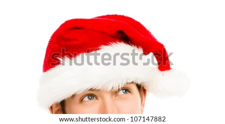 Closeup of Caucasian man wearing christmas hat for santa on white background