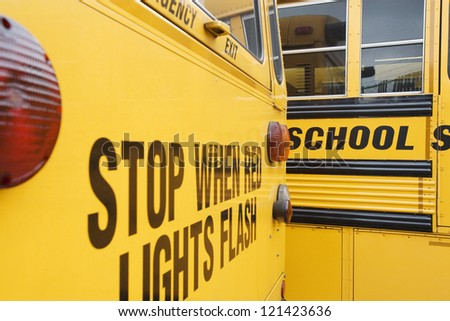 Closeup of caution written on school bus