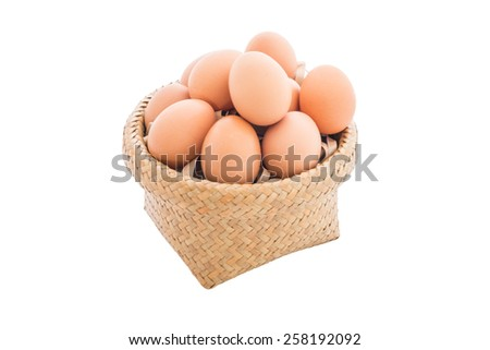 Closeup of Chicken eggs in the bamboo basket and  isolated on white background