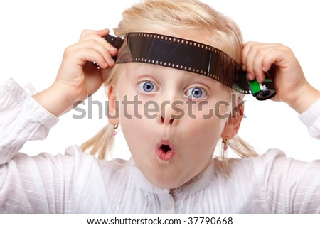 closeup of child playing with old analog camera film, isolated on white background - stock photo