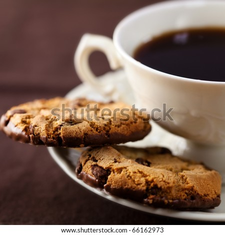 Closeup of chocolate cookies and a cup of coffee - stock photo