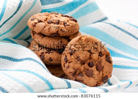 Closeup of chocolate cookies on a blue napkin - stock photo