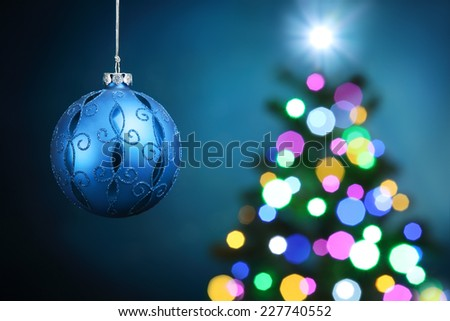 Closeup of Christmas ball on festive background